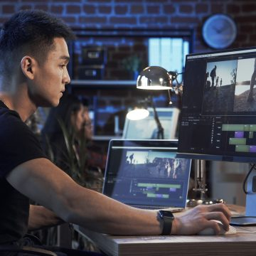 A man and a woman using a computer