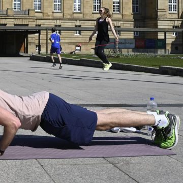 A man doing workouts on floor